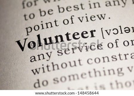 Fake Dictionary, Dictionary definition of the word Volunteer. - stock photo