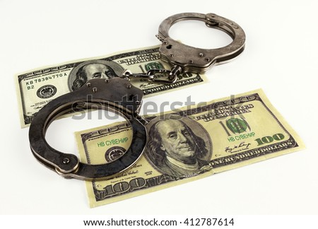 fake dollars with handcuffs isolated on white background.
