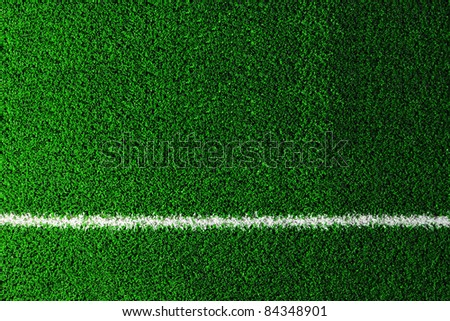 fake grass and line used on sports fields for soccer, baseball, golf and football - stock photo
