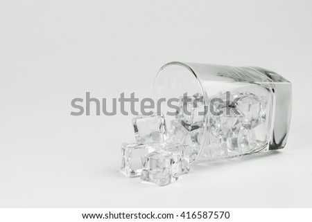 Fake ice in a glass on white background. - stock photo
