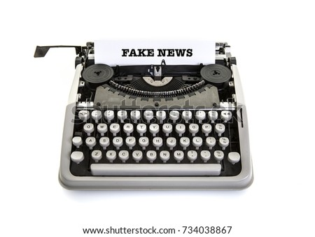 Fake News on an old vintage typewriter on a white background