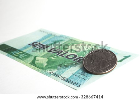 Fake one real bill (brazilian) money with a quarter coin. - stock photo