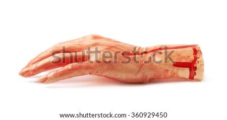 Fake severed hand isolated - stock photo