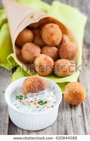 Falafel, middle eastern deep fried chickpea balls with tzatziki sauce - stock photo