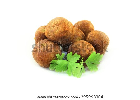 Falafel with fresh parsley on a light background - stock photo
