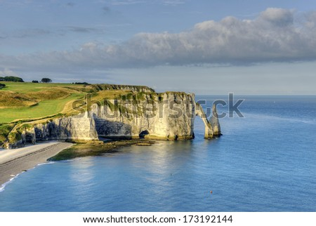 Falaise d`Aval, coast near the village d'Etretat - commune in the Seine-Maritime department in the Haute-Normandie region in northwestern France. Etretat is now a famous French seaside resort. - stock photo