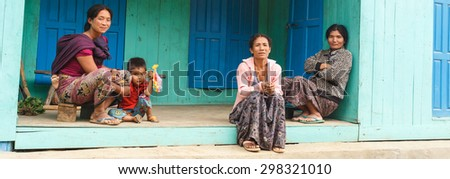 FALAM, MYANMAR - JUNE 17 2015: Local family in the recently opened to foreigners area of Chin State - western Myanmar (Burma)