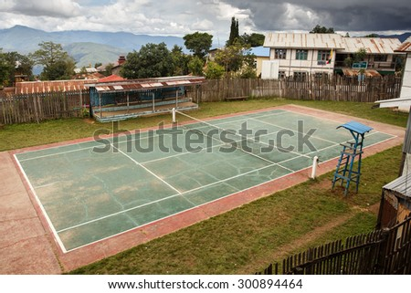 FALAM, MYANMAR - JUNE 18 2015: Tennis court in Falam in the recently opened to foreigners area of Chin State - western Myanmar (Burma) - stock photo