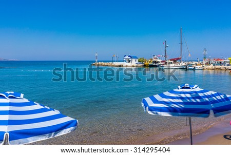 Faliraki Beach and Harbour entrance Rhodes Greece Europe - stock photo