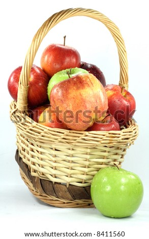 Fall apples assorts in basket. Basket with Apples different sorts with water drops over in group over white.