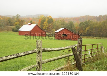 fall background with red barns - stock photo