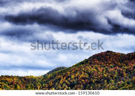 Fall color and rain clouds,  West Virginia, USA - stock photo