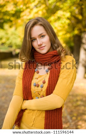 Fall color harmony, fashionable gorgeous young blond outdoors in the park. - stock photo