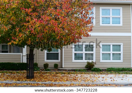 Fall color is even evident in the urban environment of these apartments for low-income seniors. - stock photo