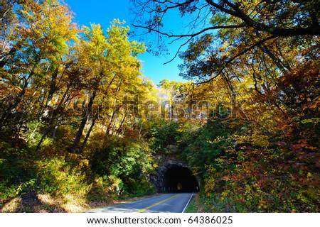 Fall colors and North Carolina mountain tunnel - stock photo