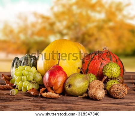 Fall fruit and vegetables on wood. Thanksgiving concept of harvested food