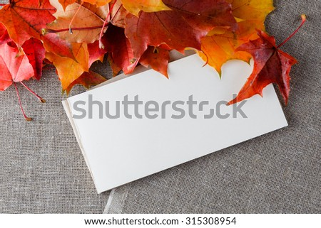 Fall leaves, bright canvas and craft paper for inscription - stock photo