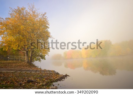 Fall Misty Morning on the River (on the Kennebecasis River in Hampton, New Brunswick, Canada) - stock photo