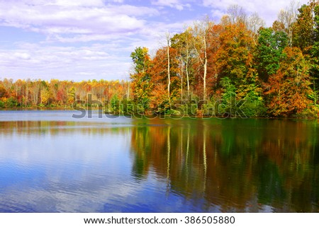 Fall reflections in the ripples on the water in Beaverdam reservoir in Gloucester county, southeastern tidewater Virginia. - stock photo