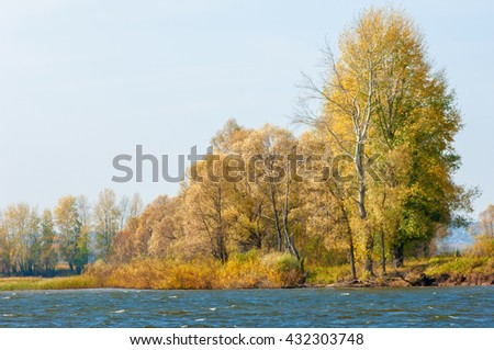 fall river. Autumn colorful foliage over lake with beautiful woods in red and yellow color. Autumn landscape with a river. Beautiful autumnal scene, fall