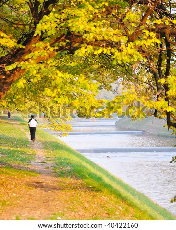 Fall scene beside the river - stock photo