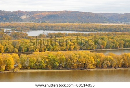 Fall scene: Trees with yellow leaves on islands in Mississippi River bordering Iowa and Wisconsin, viewed from Fire Point in Effigy Mounds National Monument - stock photo