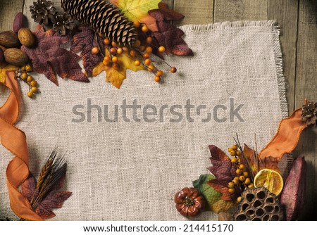 Fall Season card with Nature Elements in Rustic Setting with Burlap and old wood background from above with empty room or space for copy, text, your words, horizontal.  Vintage warm tones - stock photo