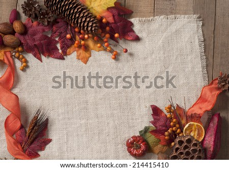 Fall Season card with Nature Elements in Rustic Setting with Burlap and old wood background from above with empty room or space for copy, text, your words, horizontal. - stock photo
