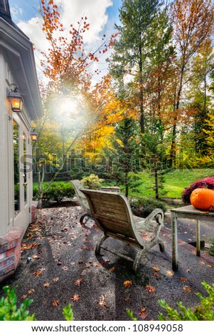 Fall sunshine on suburban patio and garden - stock photo