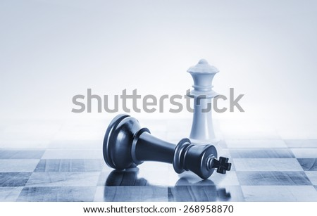 Fallen chess king as a metaphor for fall from power - stock photo