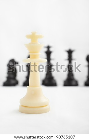 Fallen king pieces surrounded by the other color chess pieces