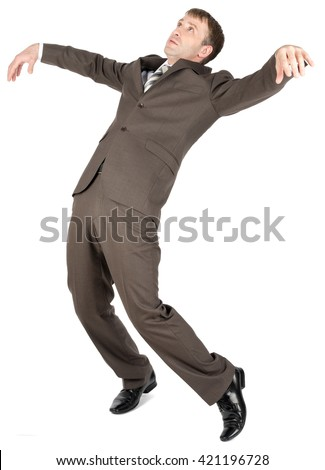 Falling businessman in formal wear over white background - stock photo