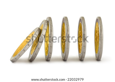 Falling coins like a domino isolated on white background - stock photo