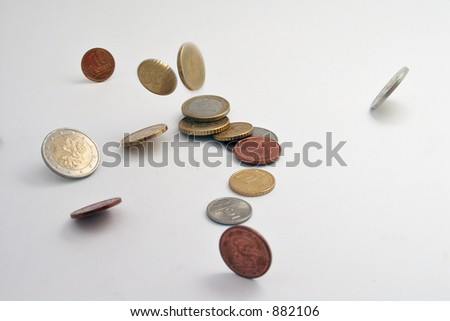 falling coins on white background - stock photo