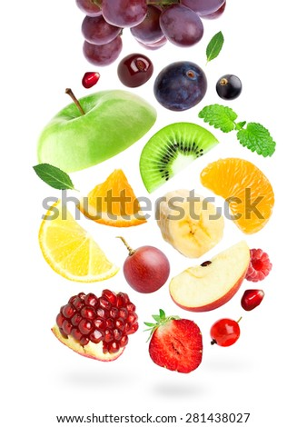 Falling color fruits and berries on white background