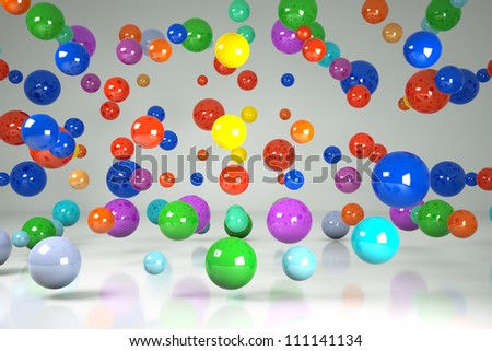 falling colorful three-dimensional balls on a gray background - stock photo