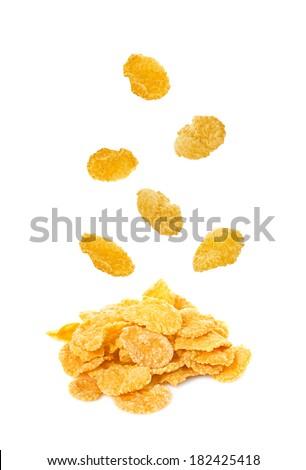 falling corn flakes isolated on white background - stock photo
