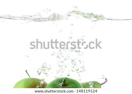 falling deeply under water with a big splash on white background  - stock photo