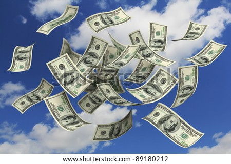 Falling Dollars from the sky - stock photo