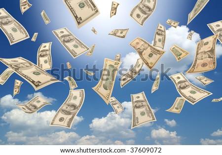 Falling dollars (sunny sky background) - stock photo