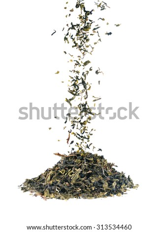 Falling dried green tea leaves isolated on white background.