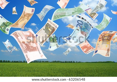 Falling euros (field background) - stock photo