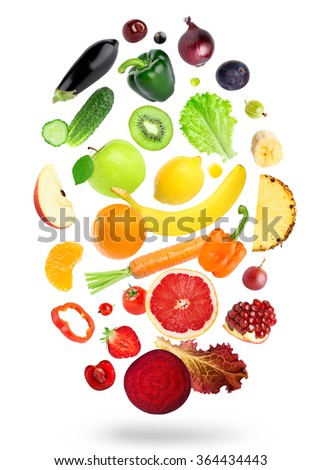 Falling fresh color fruits and vegetables on white background