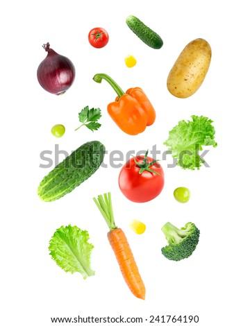 Falling fresh vegetables on white background - stock photo