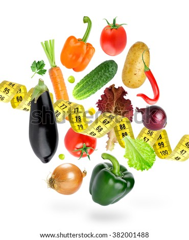 Falling fresh vegetables on white background. Diet. Fresh food