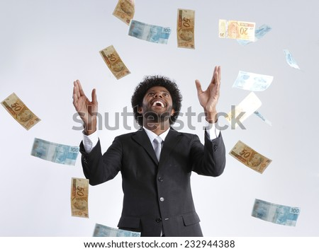 falling money in the hands of a businessman - stock photo