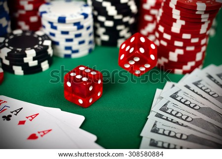 falling poker dice on green table
