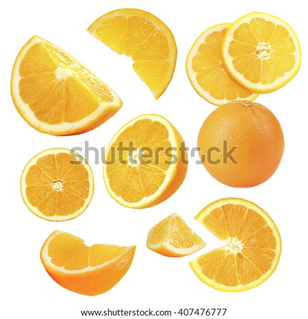 Falling ripe oranges isolated on white