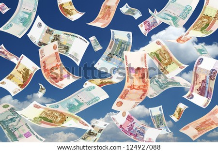 Falling Roubles on sky background. Conceptual business image. - stock photo