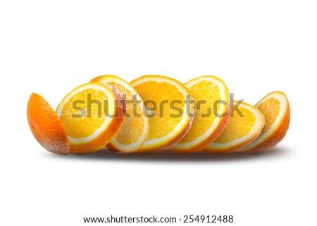 Falling slices of orange isolated on white - stock photo